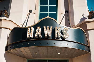Hawks signage in front of restaurant